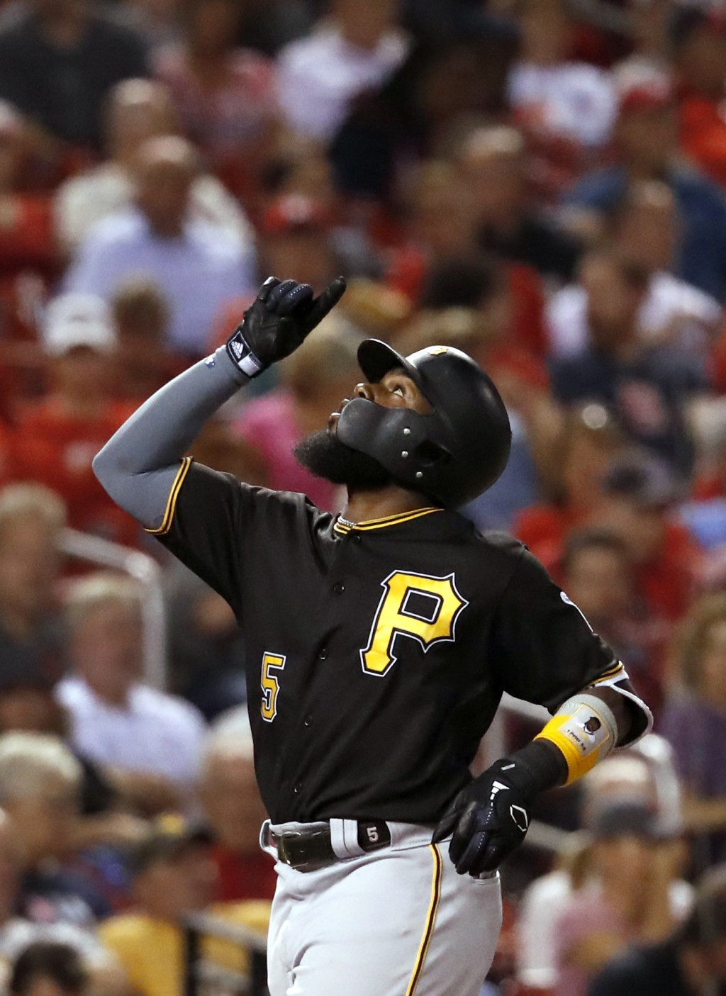 Pittsburgh Pirates' Josh Harrison points skyward as he arrives home after hitting a solo home run during the sixth inning of a baseball game against t
