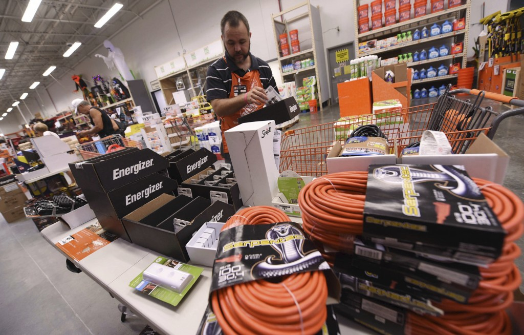 James Wemyss puts out more supplies at The Home Depot on Monday, Sept. 10, 2018, in Wilmington, N.C. Florence rapidly strengthened into a potentially