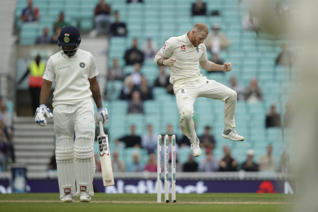 England's Ben Stokes celebrates taking the wicket of India's Hanuma Vihari, left, during the fifth cricket test match of a five match series between E