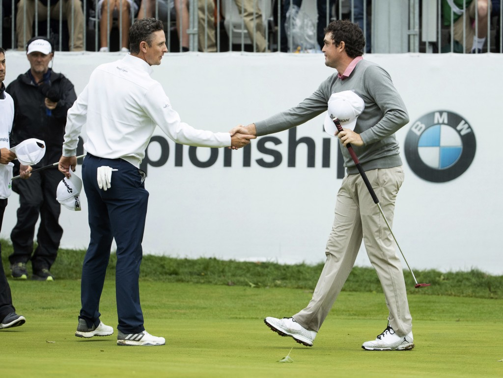Justin Rose, of England, left, and Keegan Bradley shakes hands after the BMW Championship golf tournament at the Aronimink Golf Club, Monday, Sept. 10