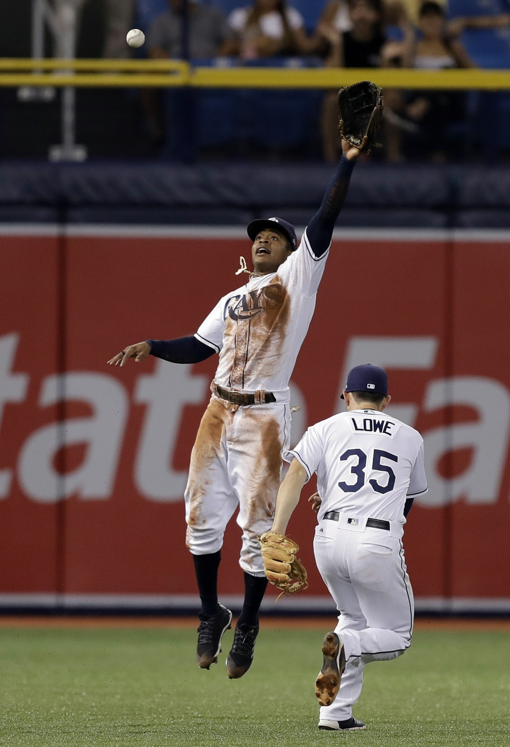 Tampa Bay Rays center fielder Mallex Smith and shortstop Brandon Lowe (35) can't get a double by Cleveland Indians' Jose Ramirez during the fifth inni