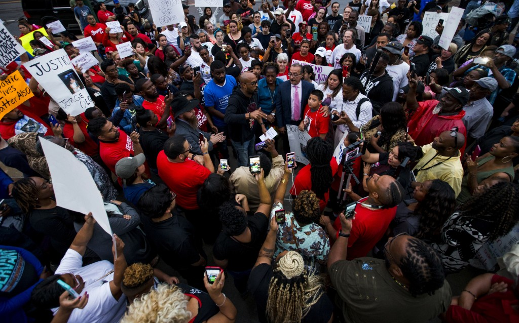 Protesters in the shooting death of Botham Jean, gather at the Jack Evans Police Headquarters, Monday, Sept. 10, 2018 in Dallas. Jean was shot Thursda
