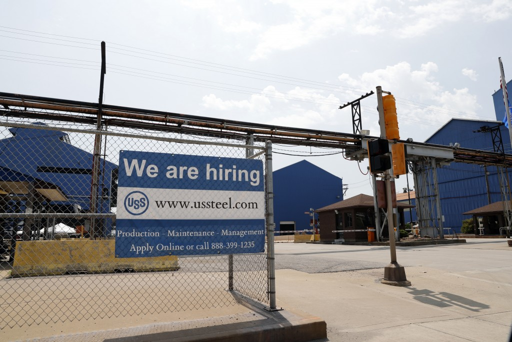 FILE- In this June 28, 2018, file photo, a help wanted sign hangs outside the U.S. Steel Granite City Works facility in Granite City, Ill. On Tuesday,