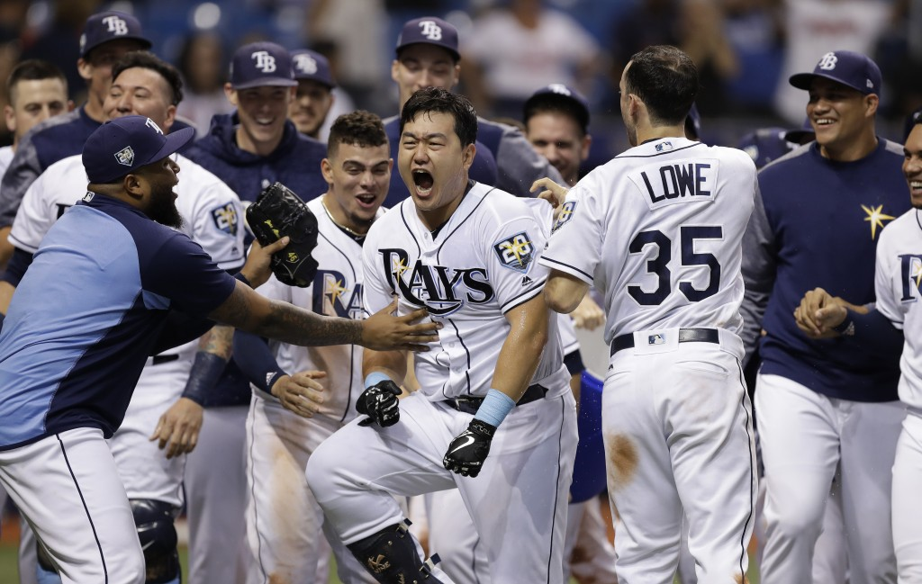 Tampa Bay Rays' Ji-Man Choi, of South Korea, center, celebrates his two-run walk-off home run off Cleveland Indians pitcher Brad Hand during the ninth