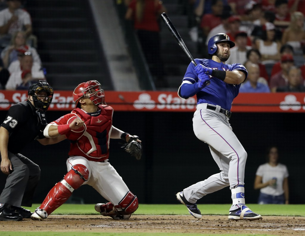 Texas Rangers' Joey Gallo follows through on a 2-RBI double against the Los Angeles Angels during the second inning of a baseball game Monday, Sept. 1