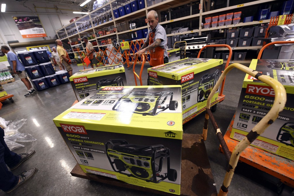 Brian Franklin prepares more generators for sale as people buy supplies at The Home Depot on Monday, Sept. 10, 2018, in Wilmington, N.C. Hurricane Flo