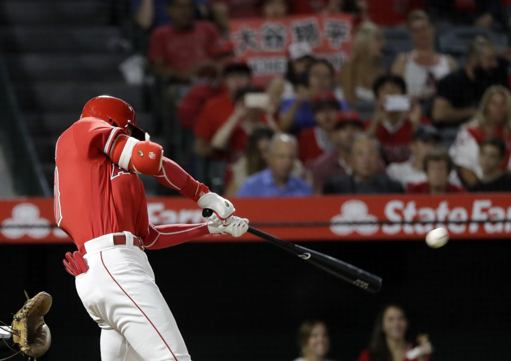 Los Angeles Angels' Shohei Ohtani hits a double against the Texas Rangers during the fourth inning of a baseball game Monday, Sept. 10, 2018, in Anahe