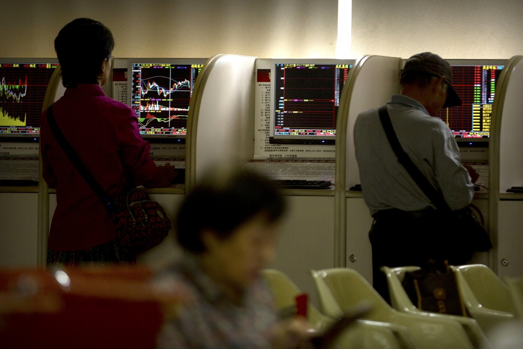 Chinese investors use computer terminals as they monitor stock prices at a brokerage house in Beijing, Tuesday, Sept. 11, 2018. Asian stocks were mixe