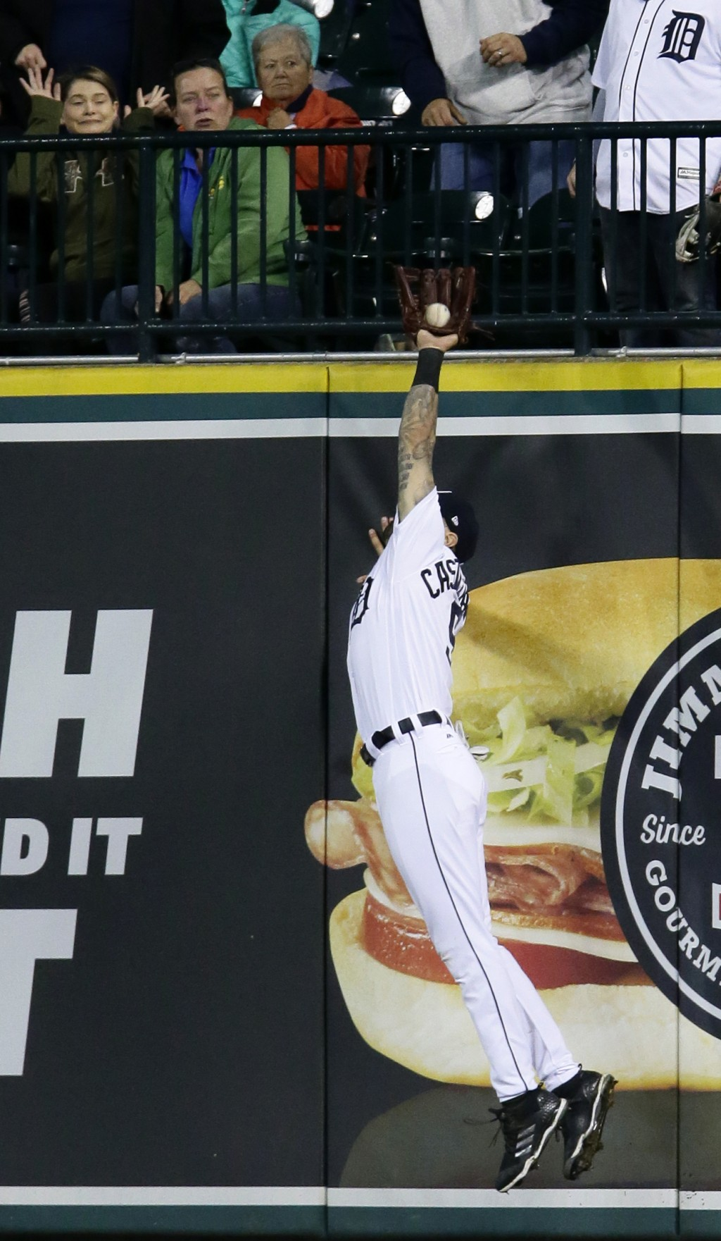 Detroit Tigers right fielder Nicholas Castellanos catches a fly ball hit by Houston Astros' Marwin Gonzalez during the eighth inning of a baseball gam