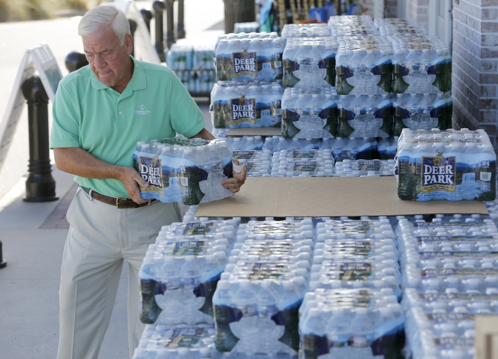 Larry Pierson, from the Isle of Palms, S.C., purchases bottled water from the Harris Teeter grocery store on the Isle of Palms in preparation for Hurr
