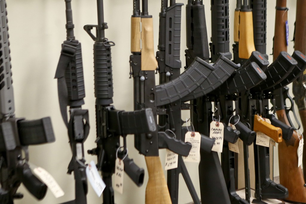 FILE - This March 1, 2018 file photo shows a display of various models of semi-automatic rifles at a store in Pennsylvania. Research published Tuesday