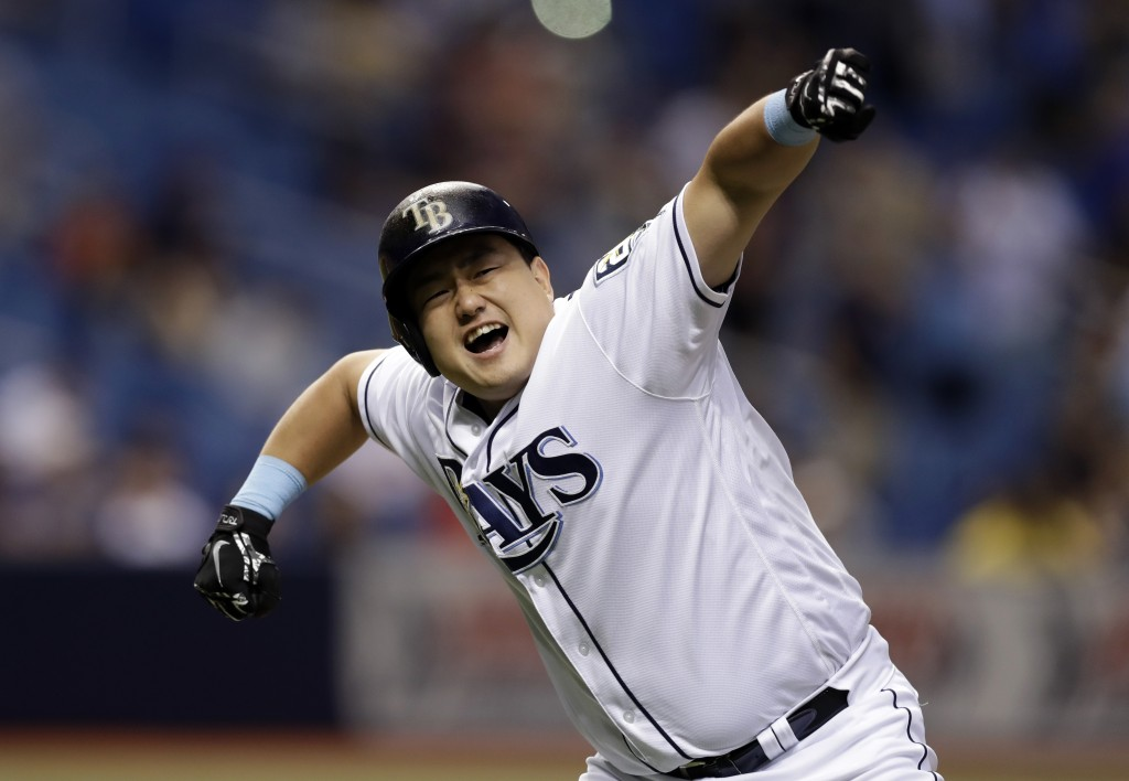 Tampa Bay Rays' Ji-Man Choi, of South Korea, celebrates his two-run walk off home run off Cleveland Indians pitcher Brad Hand during the ninth inning