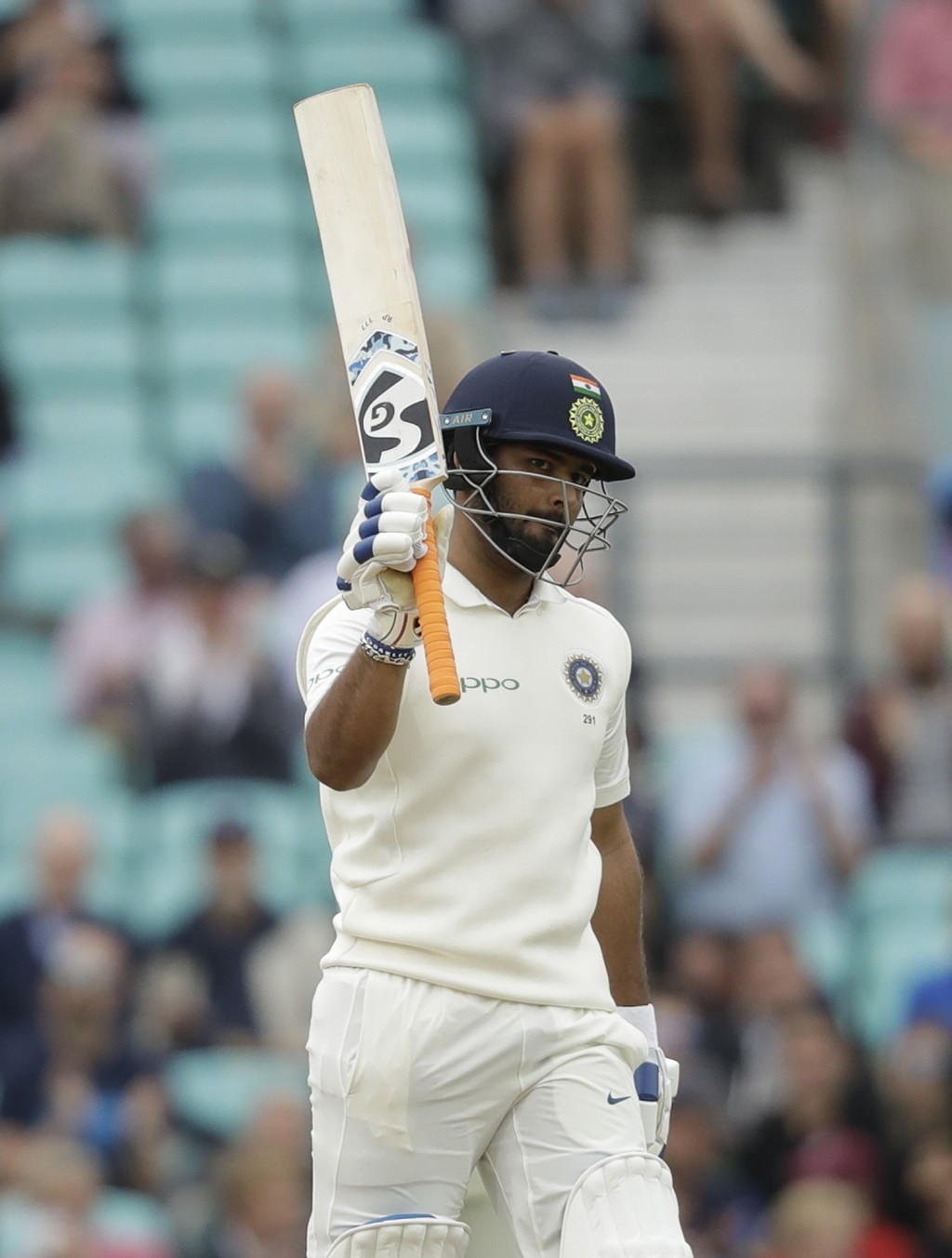 India wicketkeeper Rishabh Pant celebrates reaching 50 runs during the fifth cricket test match of a five match series between England and India at th