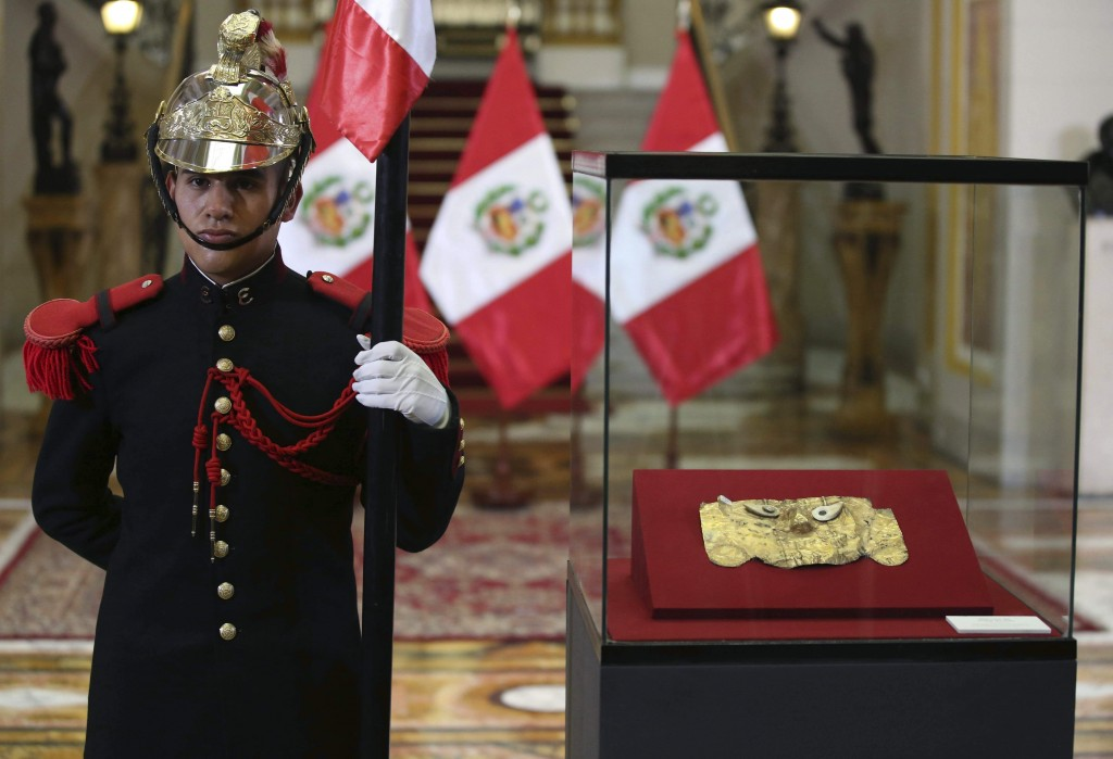 The pre-Columbian gold funerary Sican mask, that disappeared in 1999 and was recovered by Interpol in Germany, is displayed at the government Palace i