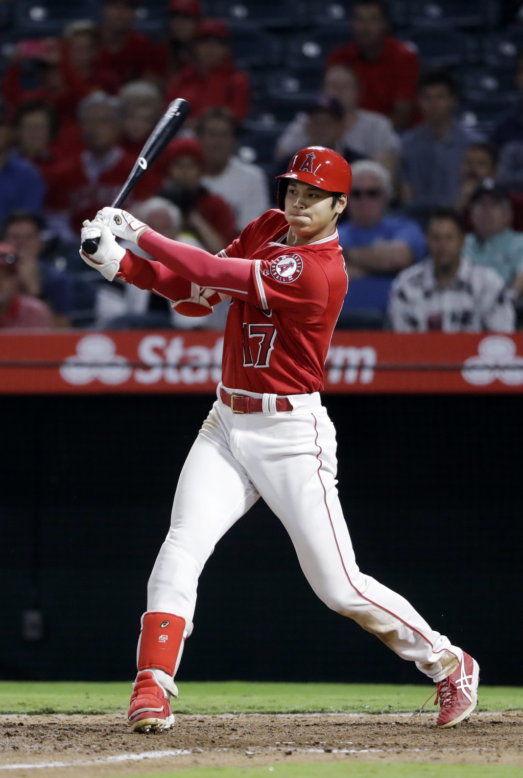 Los Angeles Angels' Shohei Ohtani follows through on an RBI single against the Texas Rangers during the seventh inning of a baseball game, Monday, Sep