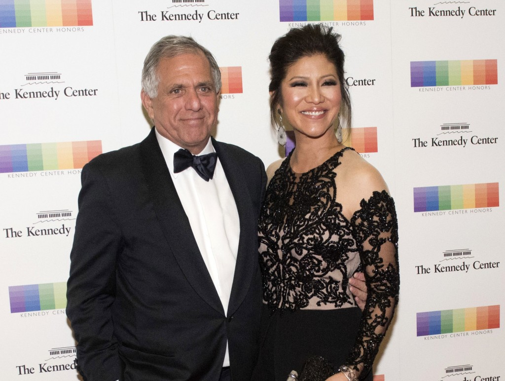 FILE - In this Dec. 2, 2017 file photo, Les Moonves, left, and his wife Julie Chen arrive for the Kennedy Center Honors gala dinner in Washington. Che