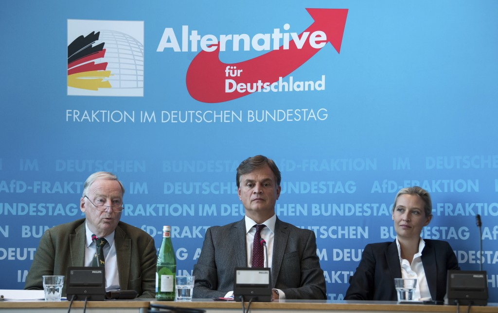 Bernd Baumann, manager of AfD Bundestag faction, is flanked by AfD's parliamentary floor leaders Alice Seidel, right, and Alexander Gauland during a p