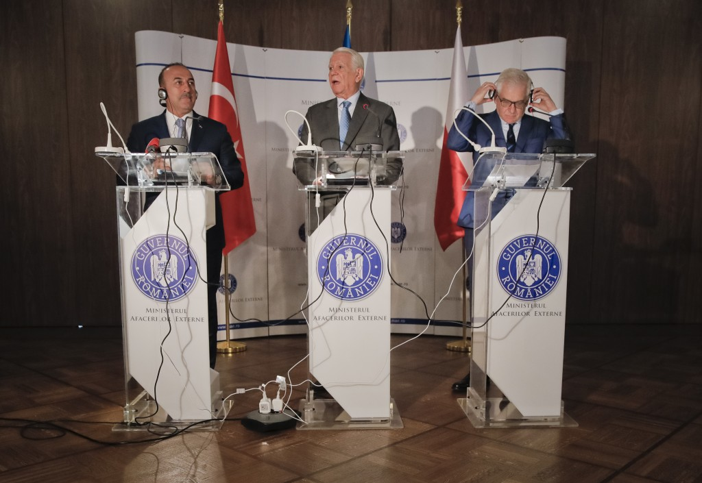 Turkey's Foreign Minister Mevlut Cavusoglu, left, Polish Foreign Minister Jacek Czaputowicz, right, and Romanian Foreign Minister Teodor Melescanu, ho