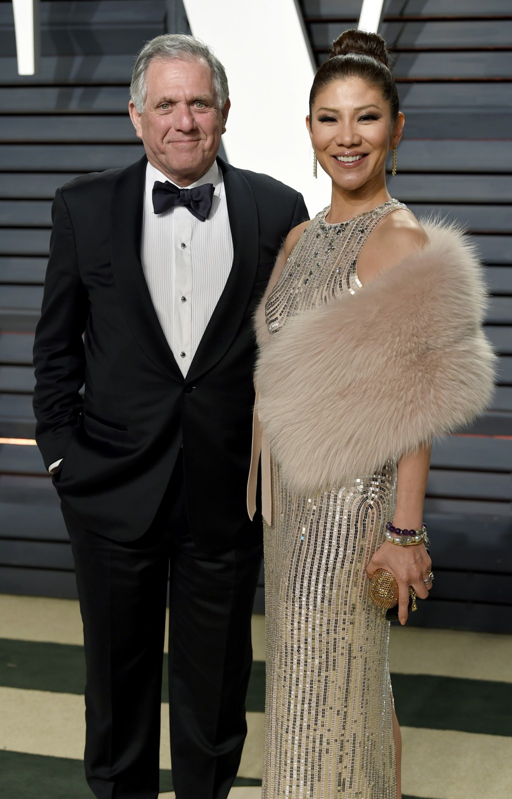 FILE - In this Feb. 26, 2017 file photo, Les Moonves, left, and Julie Chen arrive at the Vanity Fair Oscar Party in Beverly Hills, Calif. Chen was abs