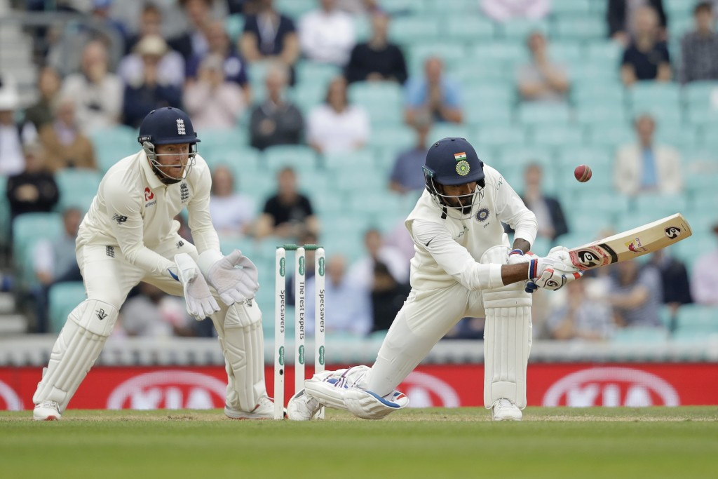 India's K. L. Rahul hits a four behind during the fifth cricket test match of a five match series between England and India at the Oval cricket ground