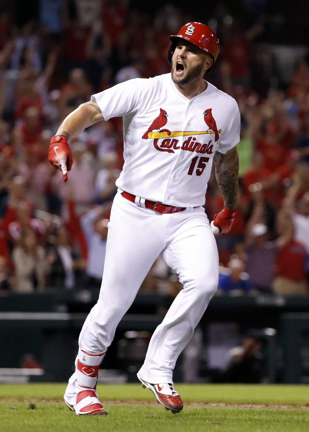 St. Louis Cardinals' Matt Adams celebrates after hitting a three-run home run during the eighth inning of a baseball game against the Pittsburgh Pirat
