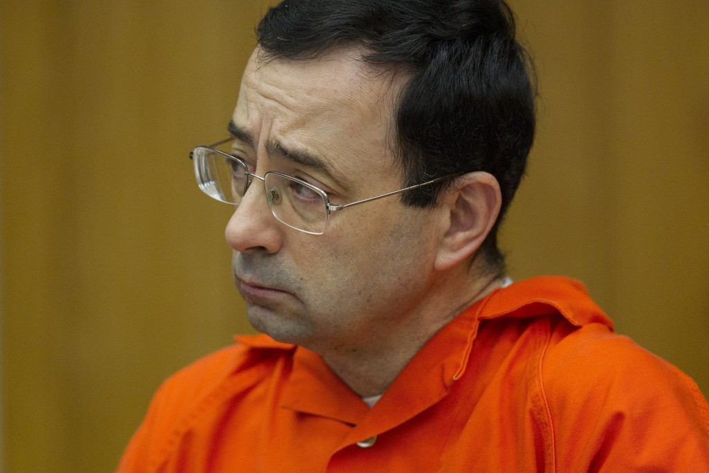 FILE - In this Jan. 31, 2018, file photo, Larry Nassar appears for his sentencing at Eaton County Circuit Court in Charlotte, Mich. Lawyers rushed to