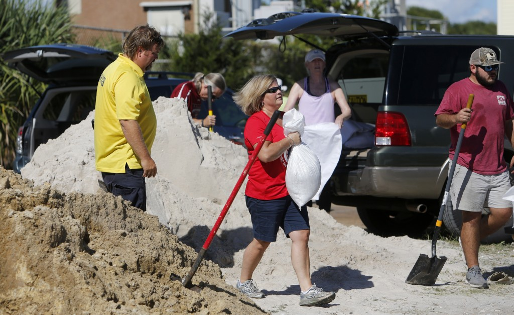 Residents of the Isle of Palms, S.C., fill sand bags at the Isle of Palms municipal lot where the city was giving away free sand in preparation for Hu