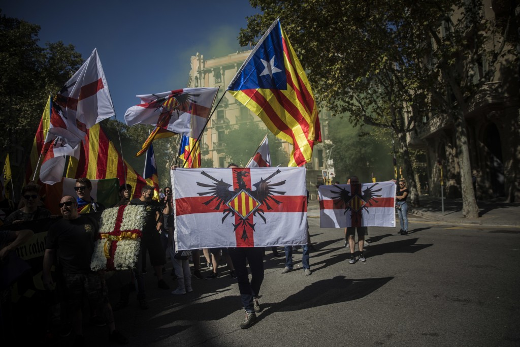 Members of an ultra-right-wing movement called 'Catalan Identitarian Movement' shout slogans during the Catalan National Day in Barcelona, Spain, Tues