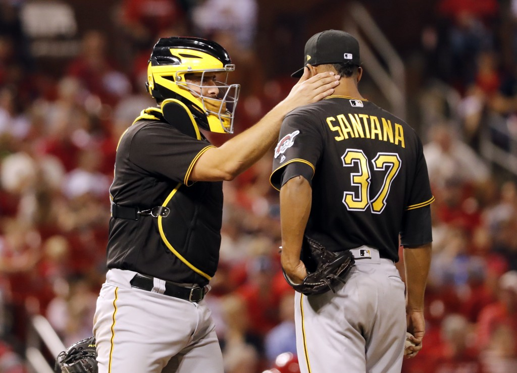 Pittsburgh Pirates catcher Francisco Cervelli, left, talks with relief pitcher Edgar Santana during the eighth inning of a baseball game against the S