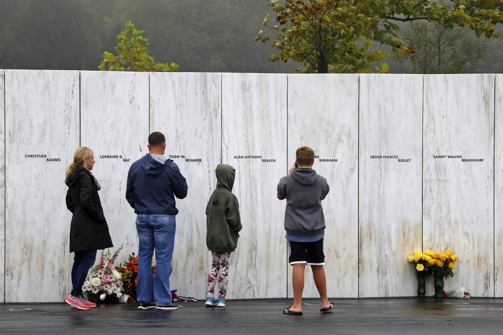 Visitors to the Flight 93 National Memorial in Shanksville, Pa., participate in a sunset memorial service on Monday, Sept. 10, 2018, as the nation mar