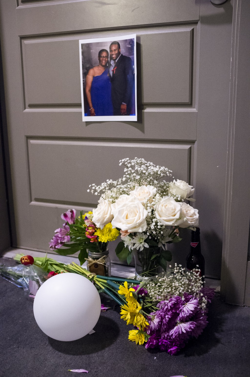 Flowers are placed at the front door of Botham Jean's apartment on Monday, Sept. 10, 2018 in Dallas. Jean was shot Thursday by off-duty Dallas police