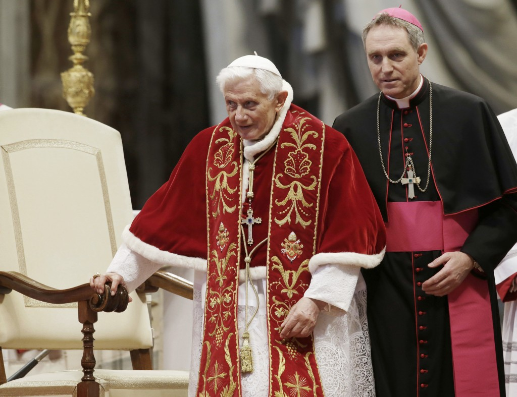 FILE - This Feb. 9, 2013 file photo shows Pope Benedict XVI flanked by personal secretary Archbishop Georg Gaenswein during a Mass to mark the 900th a