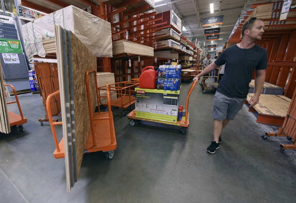 Alex Gilewicz buys supplies at The Home Depot on Monday, Sept. 10, 2018, in Wilmington, N.C. Residents of Wilmington and Southeastern N.C. Florence ra