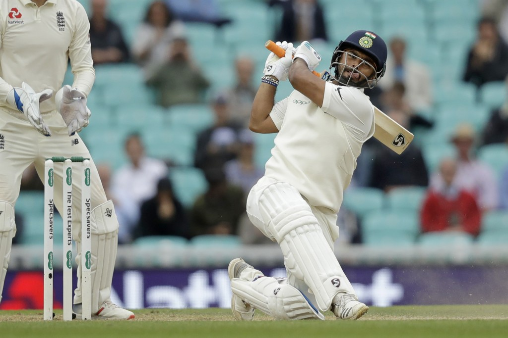 India wicketkeeper Rishabh Pant hits a six during the fifth cricket test match of a five match series between England and India at the Oval cricket gr