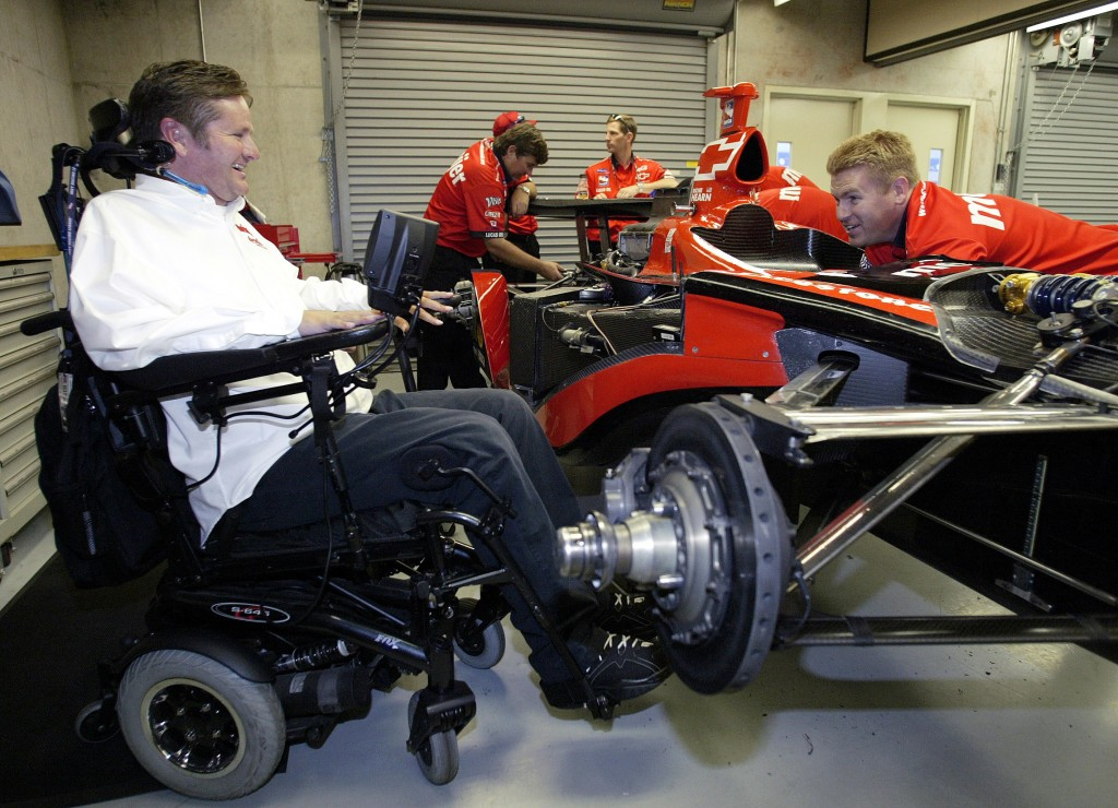 FILE - In this Friday, May 20, 2005 file photo, Indy Racing League car owner Sam Schmidt, left, talks with crew member Mike Sobeleski as he works on t