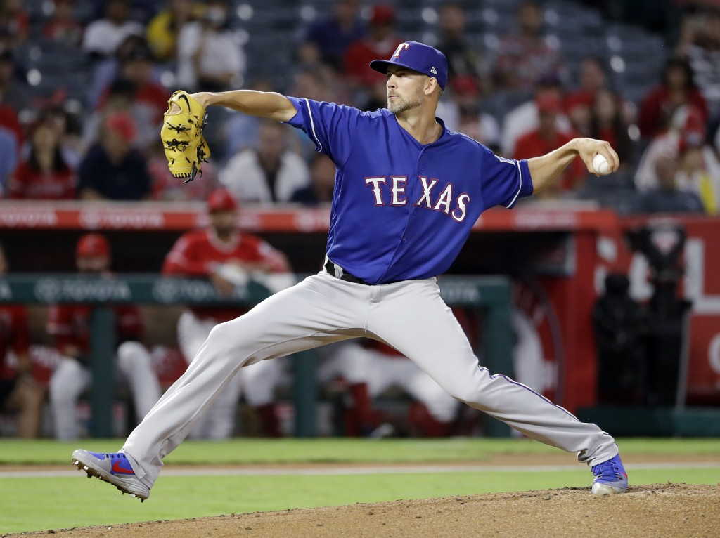Texas Rangers starting pitcher Mike Minor throws to the Los Angeles Angels during the first inning of a baseball game Monday, Sept. 10, 2018, in Anahe