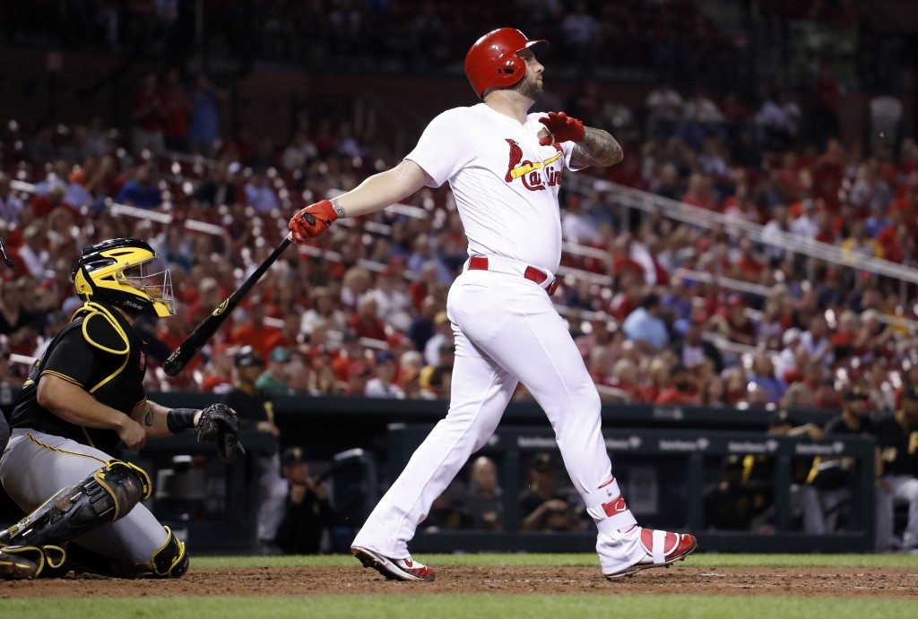 St. Louis Cardinals' Matt Adams, right and Pittsburgh Pirates catcher Francisco Cervelli watch Adams' three-run home run during the eighth inning of a