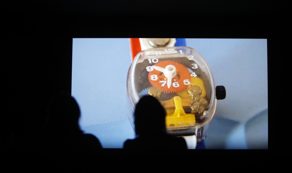 People watch a section of the 24 hour video installation by Christian Marclay entitled ' The Clock' at the Tate Modern in London, Tuesday, Sept. 11, 2