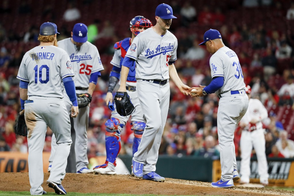 Los Angeles Dodgers starting pitcher Alex Wood , center, is relieved by manager Dave Roberts (30) in the fourth inning of a baseball game against the