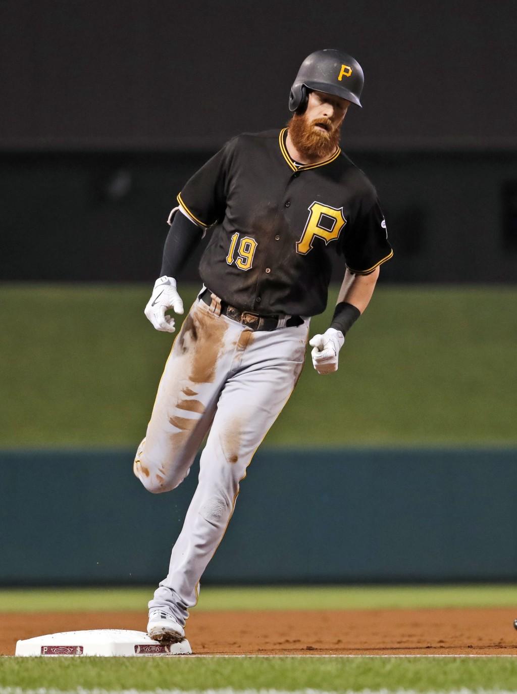 Pittsburgh Pirates' Colin Moran rounds the bases after hitting a solo home run during the second inning of a baseball game Monday, Sept. 10, 2018, in