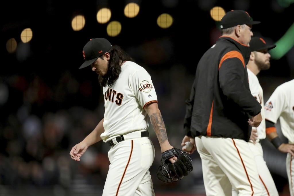 San Francisco Giants starting pitcher Dereck Rodriguez (57) leaves in the seventh inning of a baseball game against the Atlanta Braves in San Francisc