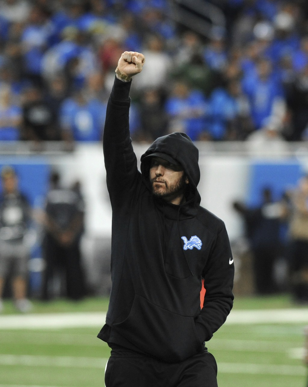 Eminem acknowledges the crowd at an NFL football game between the Detroit Lions and New York Jets in Detroit, Monday, Sept. 10, 2018. (AP Photo/Jose J