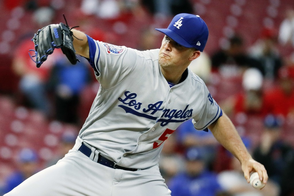 Los Angeles Dodgers starting pitcher Alex Wood throws in the first inning of a baseball game against the Cincinnati Reds, Monday, Sept. 10, 2018, in C