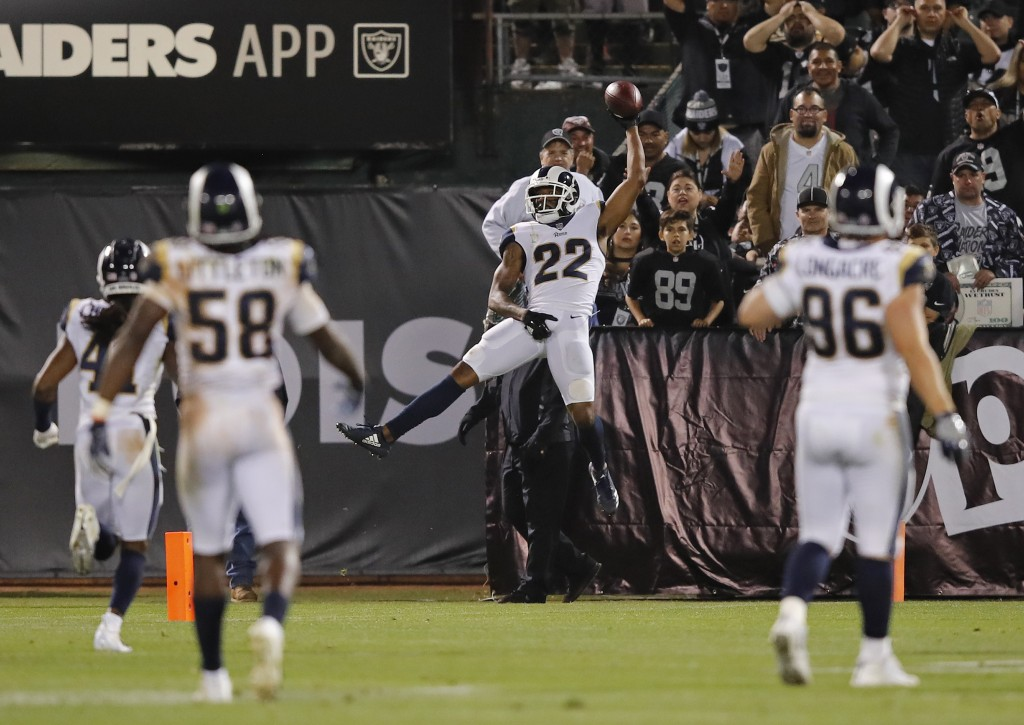 Los Angeles Rams cornerback Marcus Peters (22) celebrates in the end zone after making a 50-yard interception for a touchdown during the second half o