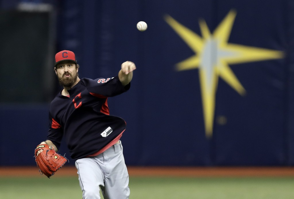 Cleveland Indians pitcher Andrew Miller throws in the outfield before a baseball game against the Tampa Bay Rays Monday, Sept. 10, 2018, in St. Peters
