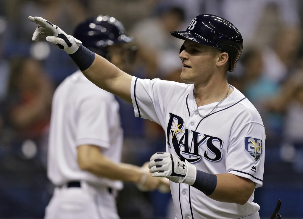 Tampa Bay Rays' Jake Bauers celebrates after his two-run home run off Cleveland Indians pitcher Corey Kluber during the second inning of a baseball ga