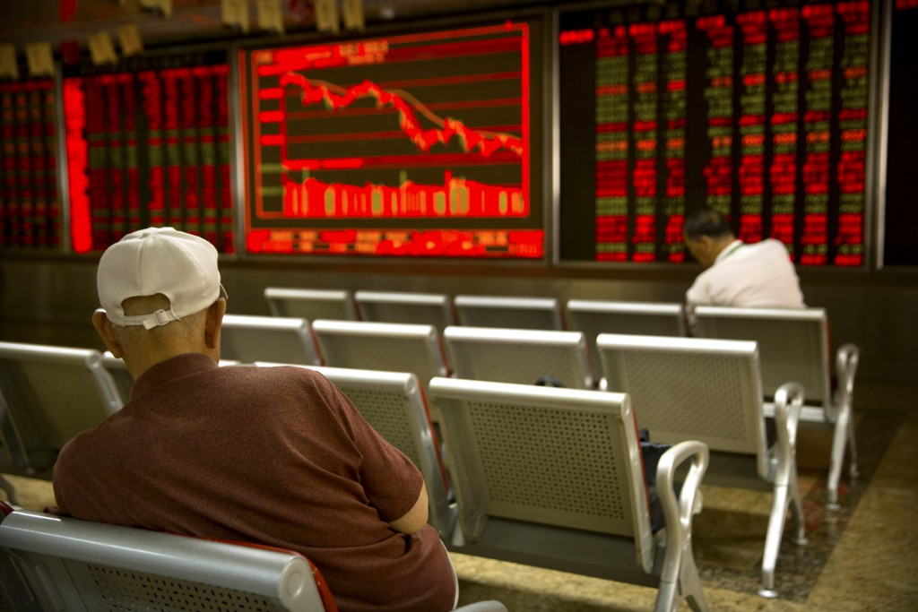 Chinese investors monitor stock prices at a brokerage house in Beijing, Tuesday, Sept. 11, 2018. Asian stocks were mixed Tuesday after Wall Street's g