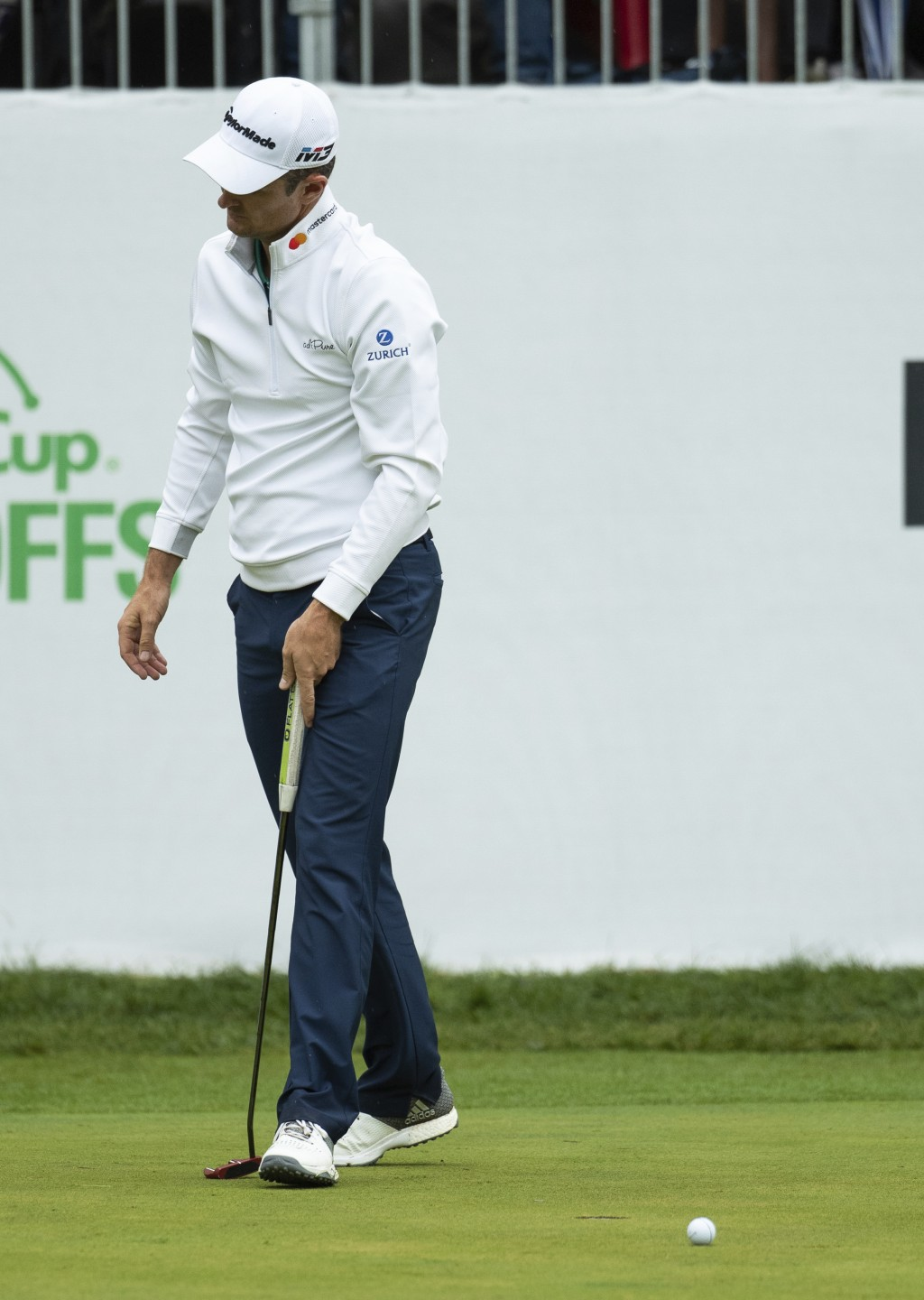 Justin Rose, of England, reacts to missing a putt for par in the playoff hole during the BMW Championship golf tournament at the Aronimink Golf Club,
