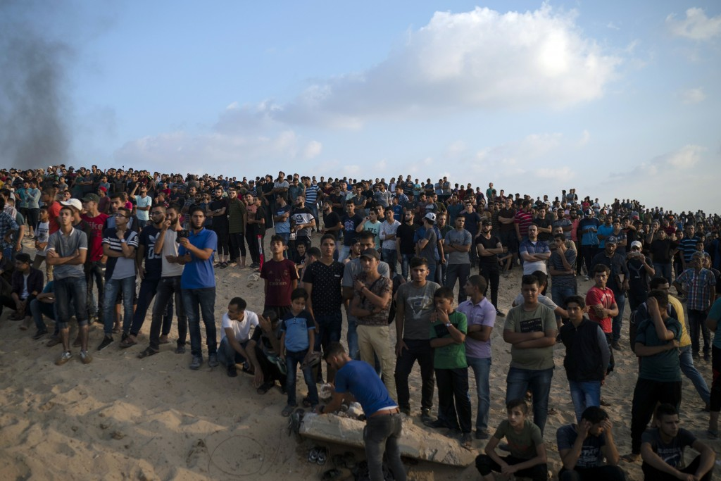 Palestinian gather during a protest on the beach near the border with Israel in Beit Lahiya, northern Gaza Strip, Monday, Sept. 10, 2018. Thousands of