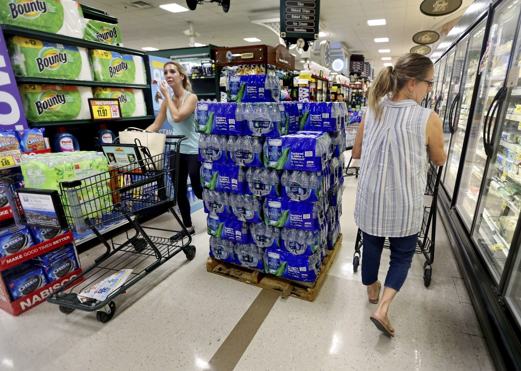 People shop at the Harris Teeter, filling up on water and supplies as Hurricane Florence becomes a threat to the coast Monday, Sept. 10, 2018, in Char